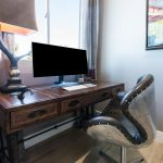 Room inside house with desk, chair, and computer
